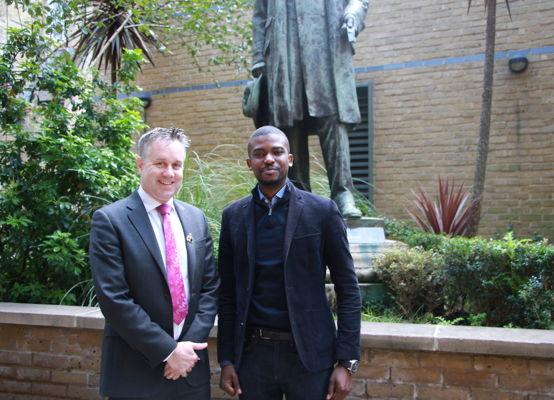 Alumnus Aaron Akinyemi with our Headteacher