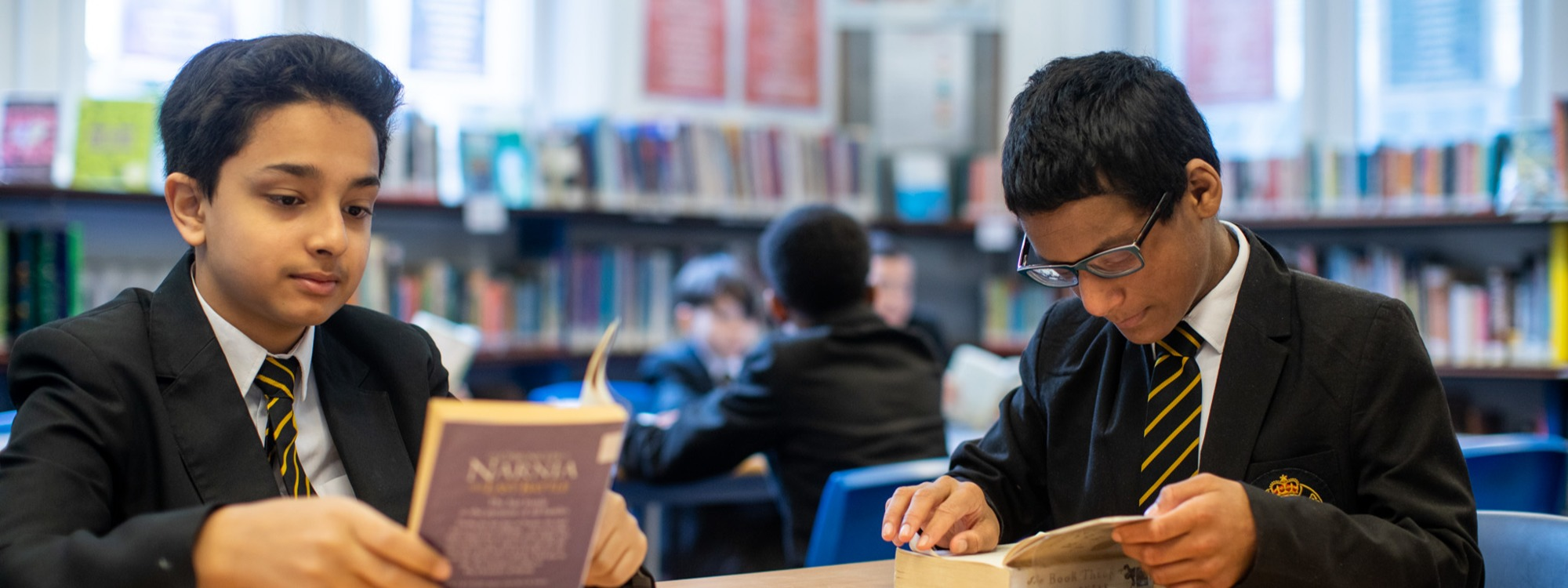 Pupils reading in library