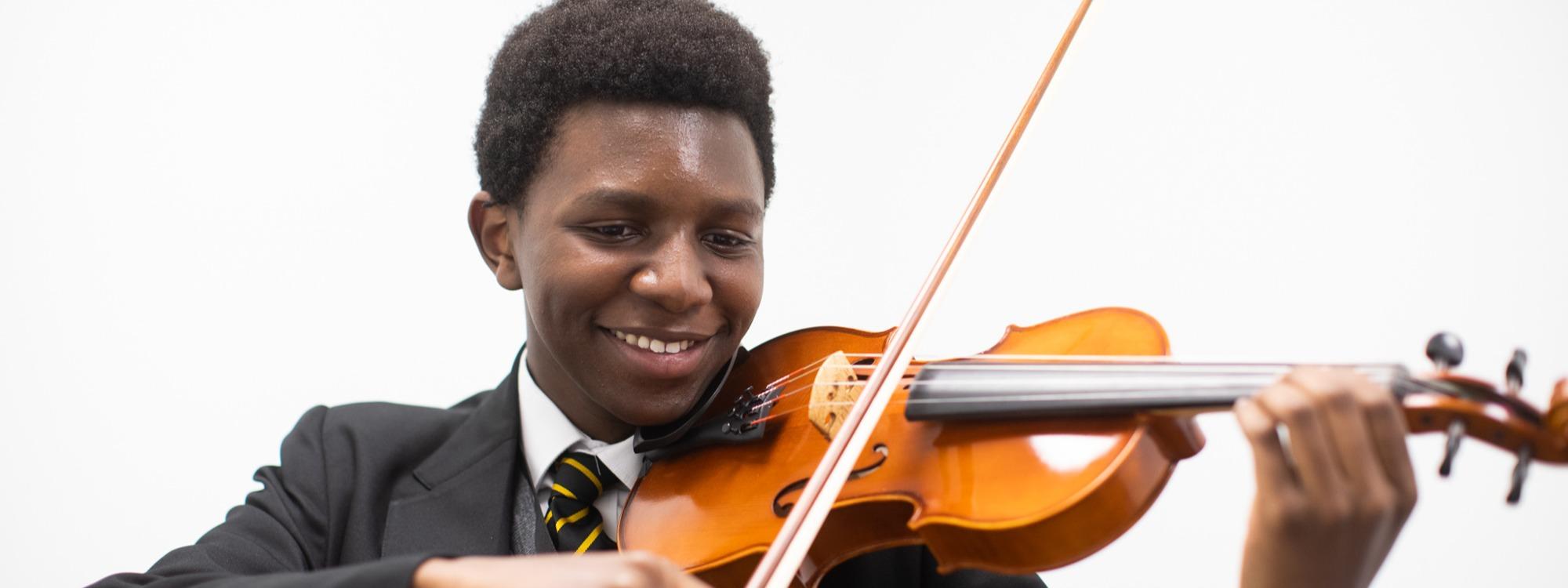 Pupil playing violin