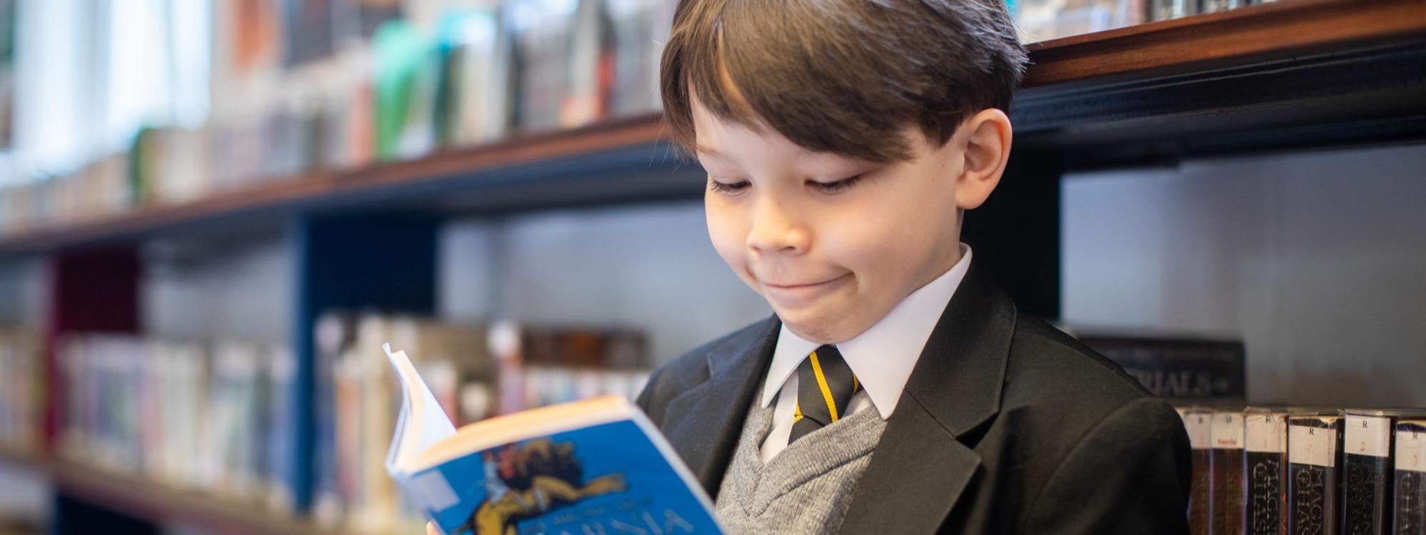Year 7 pupil reading Narnia